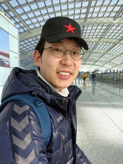 Myself, at the train station to travel back to Songzhuang