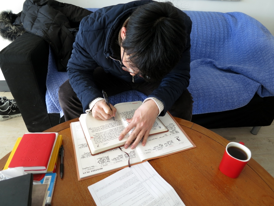 Myself, writing a journal entry in my studio